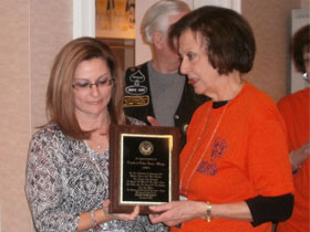 FOFH-IL Treasurer Bonnie Chattler presents to Holly Wright